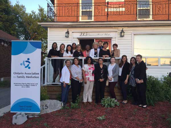 Peel Dufferin Family Mediation OAFM Chapter group photo in front of house with banner